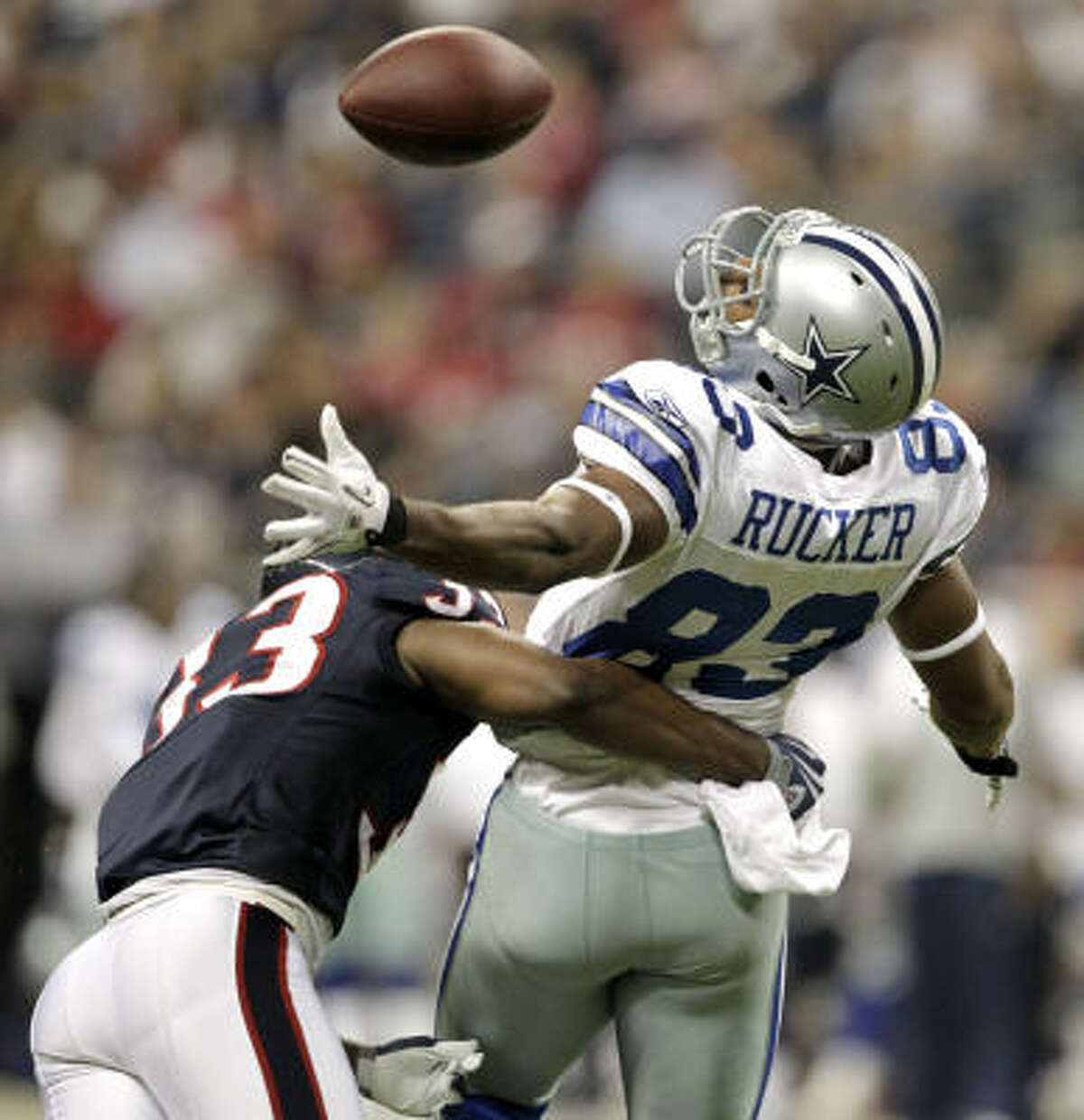 Cowboys tight end Martin Rucker fails to pull in a pass as Texans safety Troy Nolan comes in with a hit during the fourth quarter.
