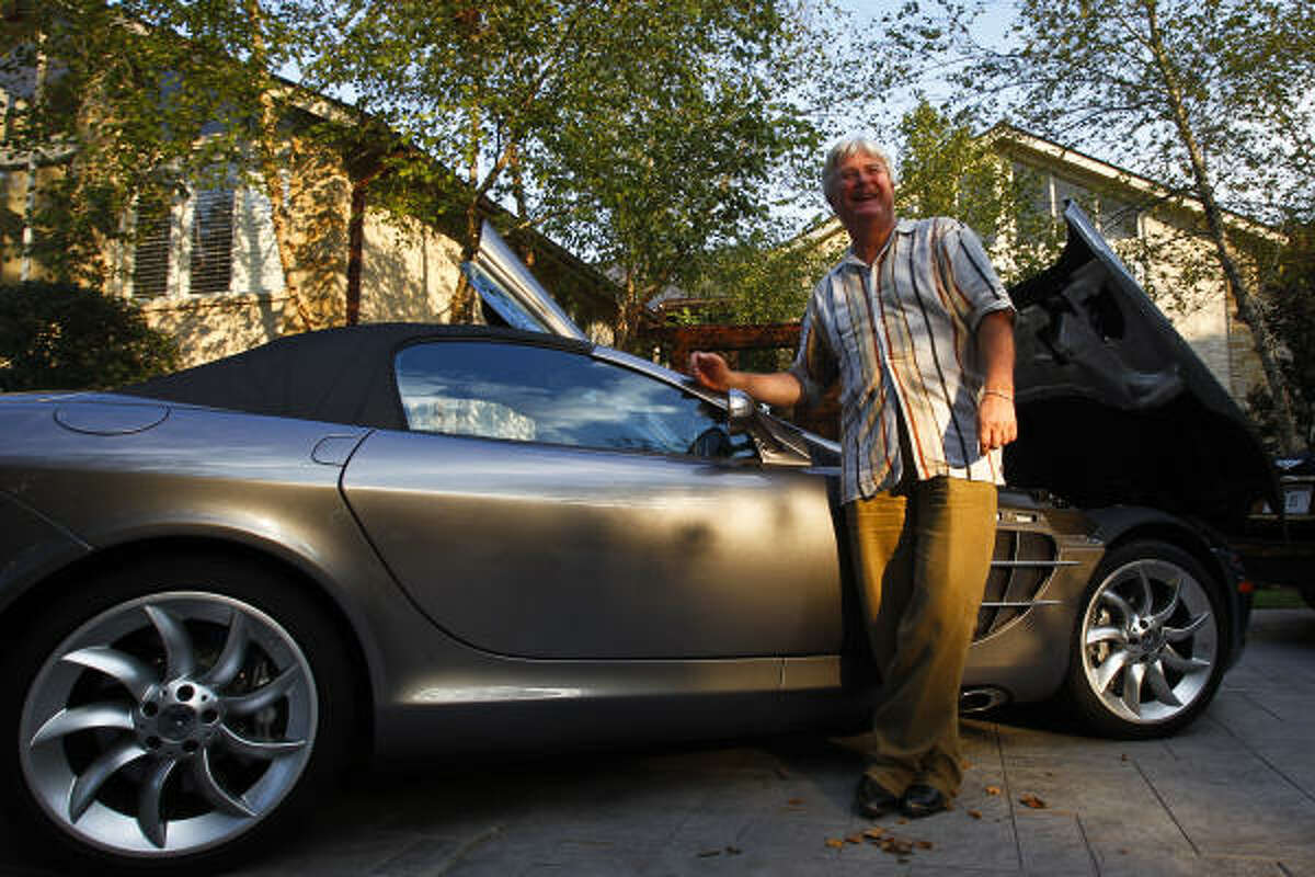 Jesse Tree official Ted Hanley stands next to a Mercedes-Benz McLaren SLR, $525,000.