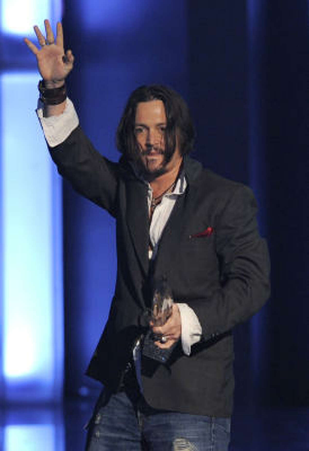 Johnny Depp accepts the award for favorite movie actor of the decade arteyett the People's Choice Awards on Wednesday Jan. 6, 2010, in Los Angeles.