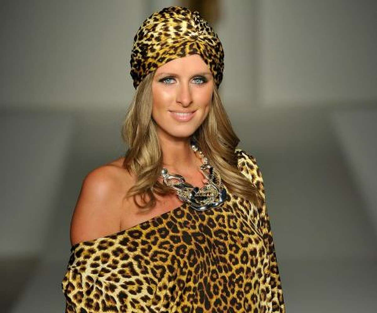 Hotel heiress Nicky Hilton in a cheetah-inspired look by Australian fashion designer Charlie Brown, known for making sexy, playful, tailored clothing