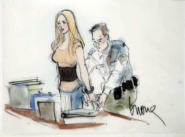 In a courtroom sketch drawn by Mona Shafer Edwards, actress Lindsay Lohan is shown in handcuffs as she is taken into custody at court in Beverly Hills, Calif., on Tuesday, July 20, 2010. Photo: Mona Shafer Edwards, AP