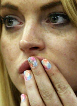 Profane language is seen on Lindsay Lohan's middle finger during a hearing in Beverly Hills, Calif. Photo: David McNew, AP