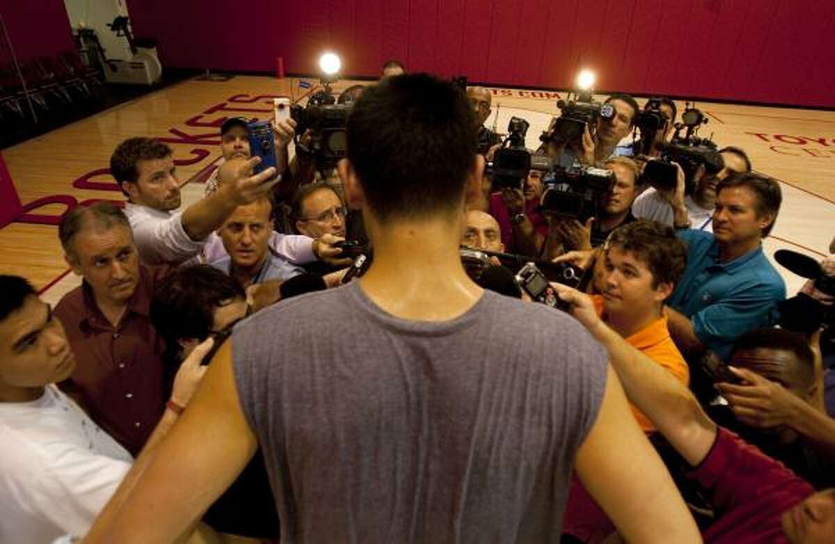 Yao Ming addresses the media after working out at the Rockets practice facility. Team doctor Tom Clanton has cleared Yao to resume basketball activities.