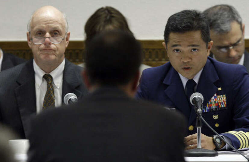 Transocean rig manager Paul Johnson, center, back to camera, testifies before a panel that includes