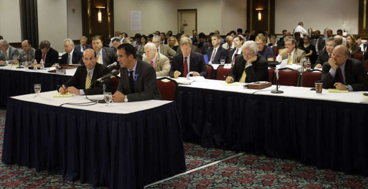 Transocean rig manager Paul Johnson, center, testifies during the Deepwater Horizon joint investigation hearings by the U.S. Coast Guard and the Interior Department's Bureau of Ocean Management, Regulation and Enforcement on Monday, Aug. 23, 2010 in Houston.