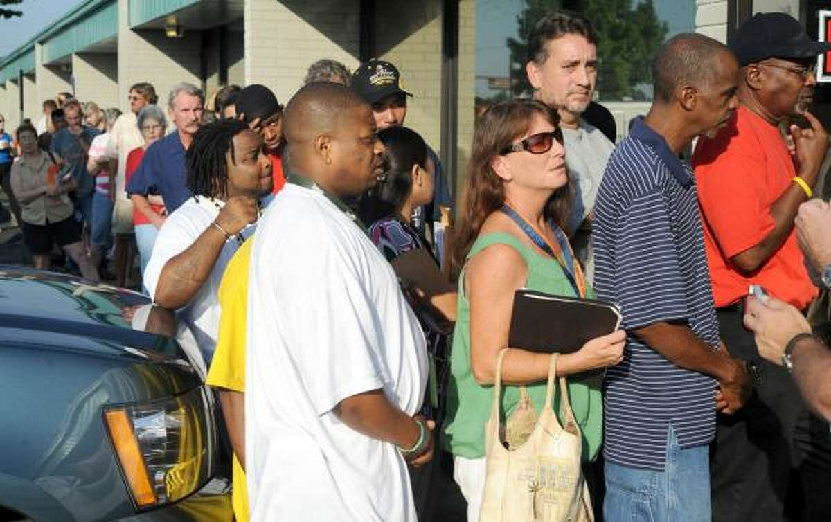 Dozens were in line Monday, Aug. 23, 2010 at the Pensacola office of the Gulf Coast Claims Facility, the new independent agency charged with compensating those who suffered damage from this summer's oil spill in the Gulf of Mexico.