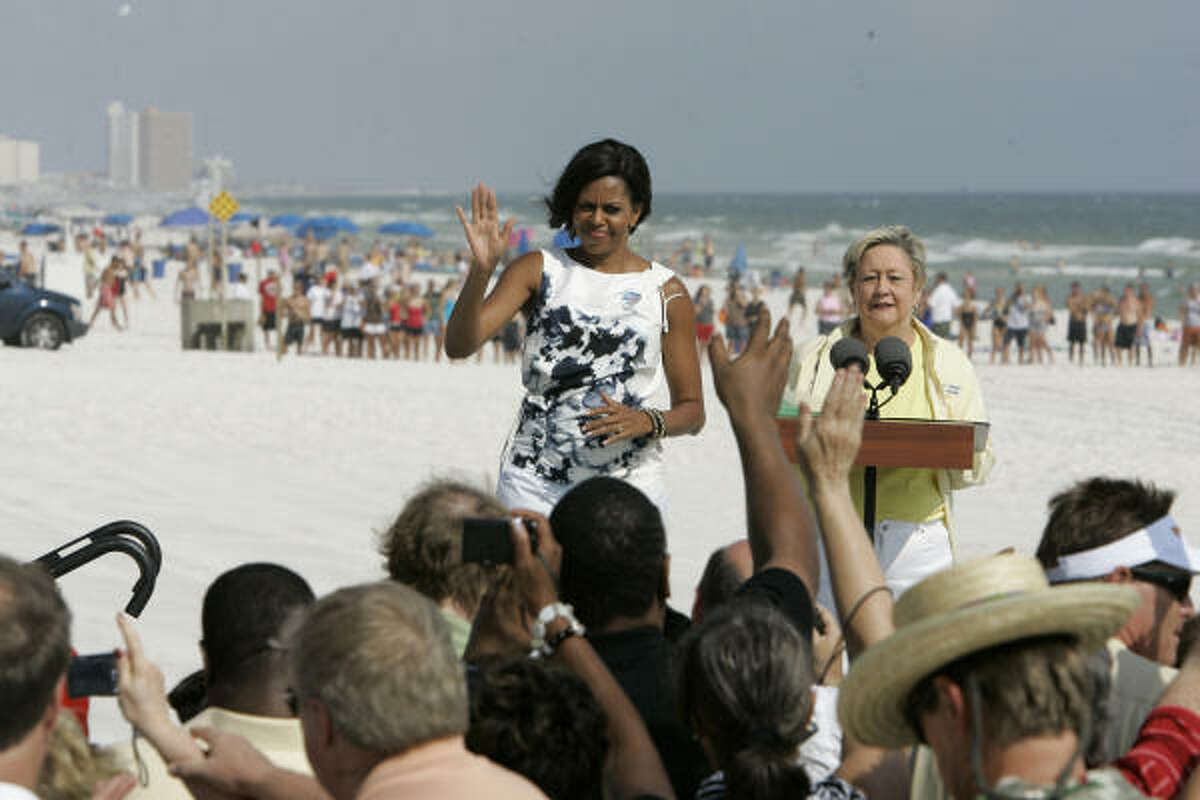 First lady Michele Obama speaks to locals at the Boardwalk Beach Resort in Panama City Beach, Fla., on Monday, July 12, 2010. Panama City Beach Mayor Gayle Oberts watches. The first lady visited to see the effects of the Gulf oil spill for herself.