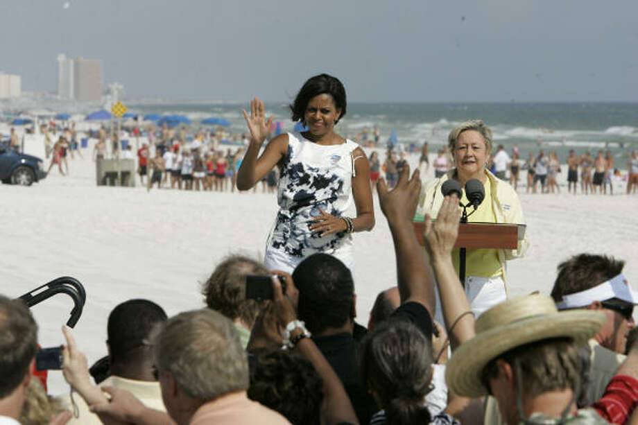First lady Michele Obama speaks to locals at the Boardwalk Beach Resort in Panama City Beach, Fla., on Monday, July 12, 2010. Panama City Beach Mayor Gayle Oberts watches. The first lady visited to see the effects of the Gulf oil spill for herself. Photo: Ric Feld, AP
