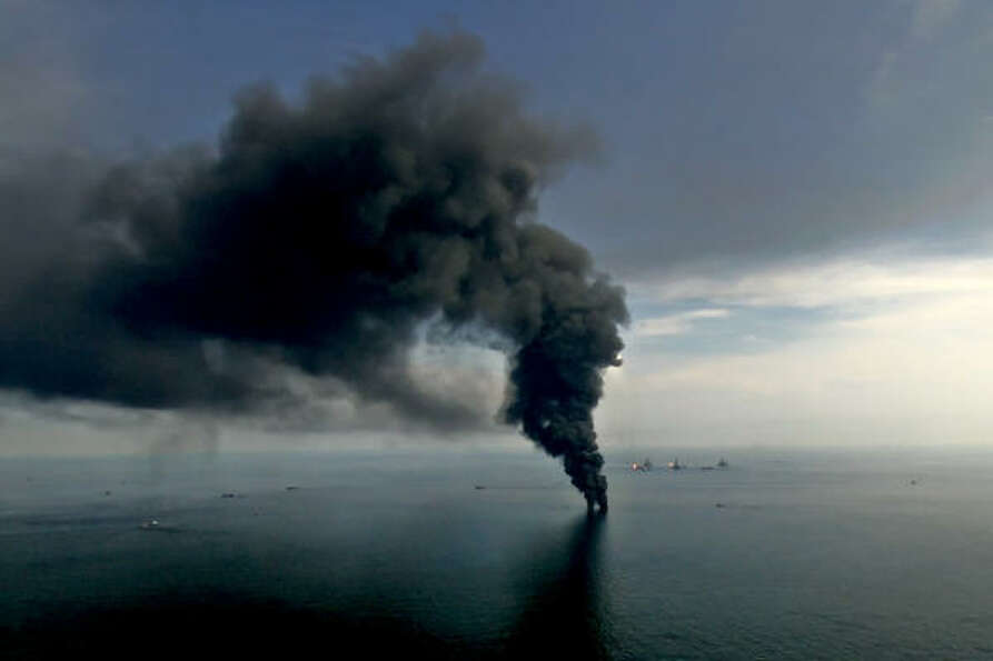 Smoke billows from controlled oil burns near the site of the BP Plc Deepwater Horizon oil spill in t