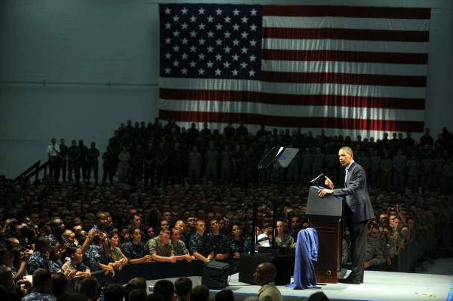 President Barack Obama addresses troops at the Pensacola Naval Air Station in Pensacola Fla., on Tue