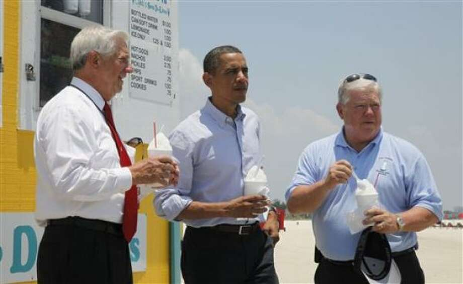 President Barack Obama stands with Mississippi Gov. Haley Barbour, right, and Gulfport, Miss., Mayor George Schloegel, left, after he met with residents affected by the BP Deepwater Horizon oil spill on Monday, June 14, 2010, in Gulfport, Miss. Photo: Charles Dharapak, AP