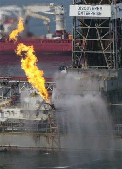 The Transocean Discoverer Enterprise burns off some natural gas as it takes on oil from the broken B