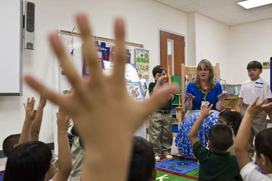 Kindergarten teacher Ana Withoff speaks with her new students during the first day of school at Piney Point Elementary. Photo: Eric Kayne, For The Chronicle