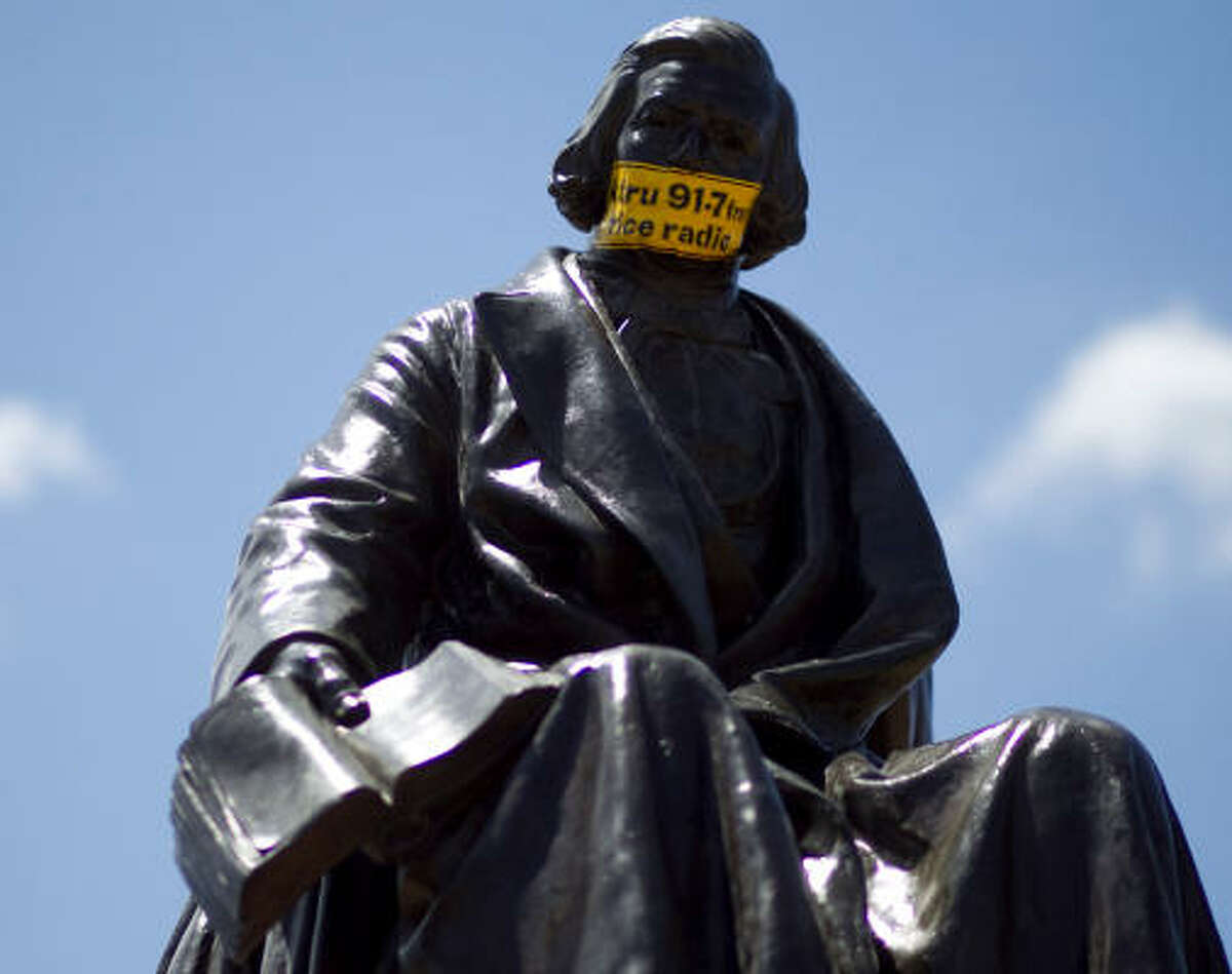 A sticker in support of Rice's student-run radio station is placed on a statue of William Marsh Rice, the founder of the school.