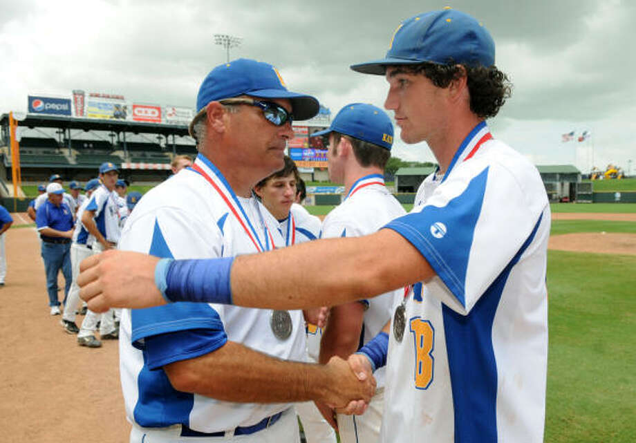 Klein head coach Barry Smith shakes hands with senior outfielder Hank Morgan after the loss. Photo: Jerry Baker, For The Chronicle