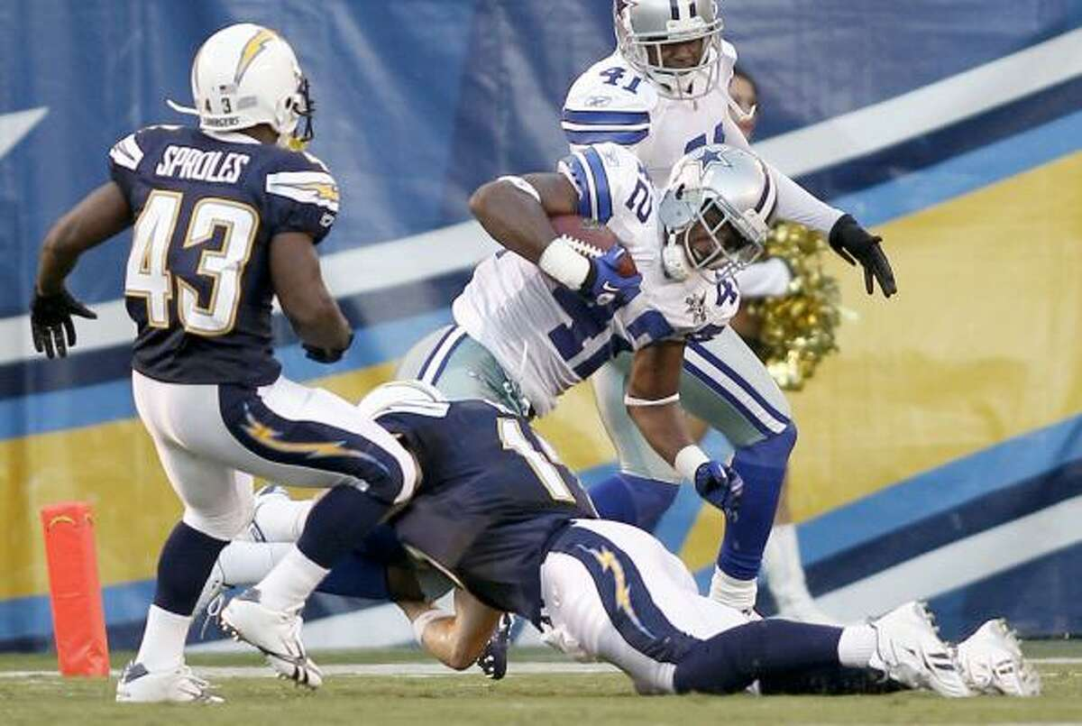 Cowboys safety Barry Church scores as Chargers quarterback Philip Rivers fails to make the stop and running back Darren Sproles watches.