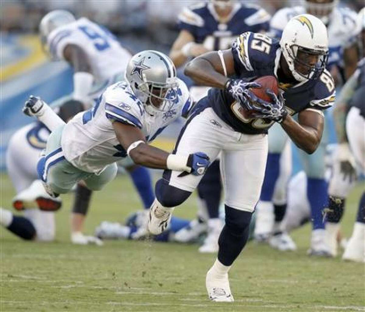 Chargers quarterback Philip Rivers gets sacked by Cowboys linebacker Anthony Spencer.