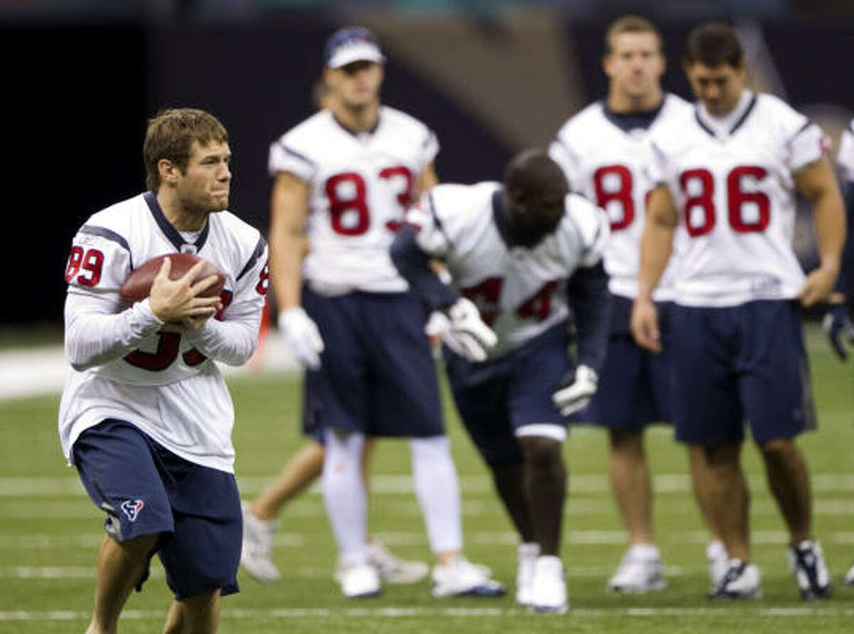 Texans receiver David Anderson makes a catch during a pre-game walk-through.