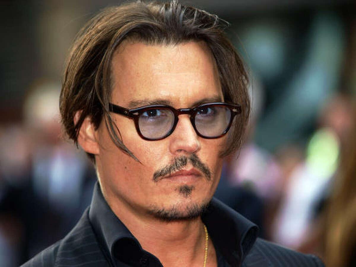 Johnny Depp Sexiest glasses alive.