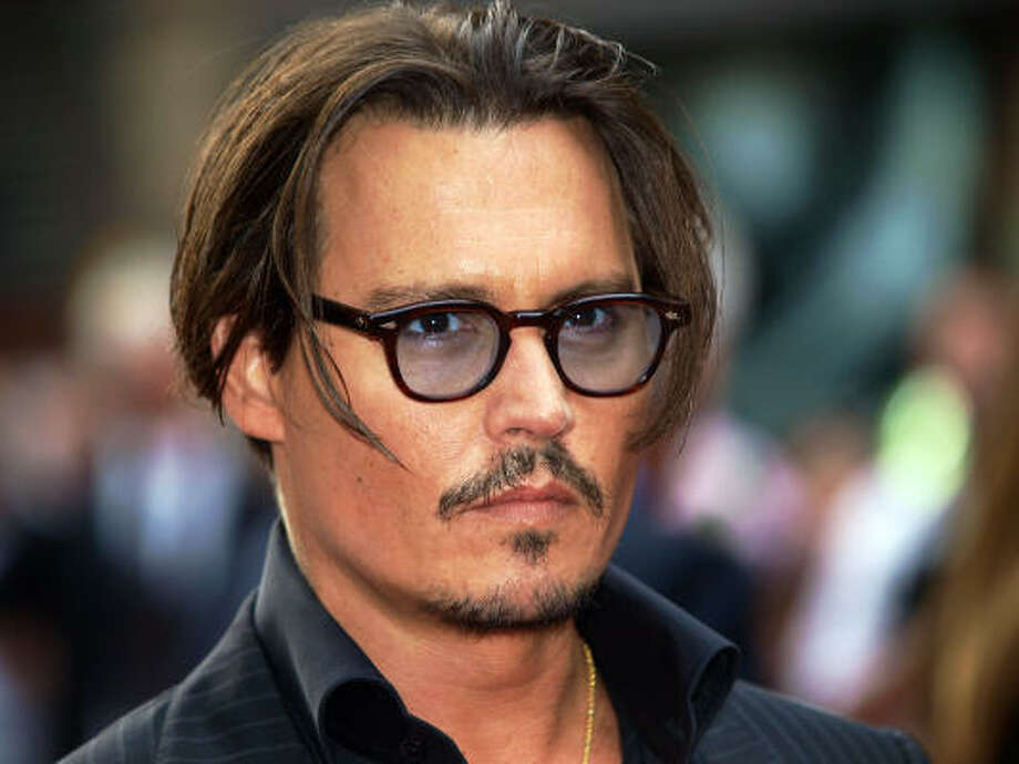 Johnny Depp Sexiest glasses alive. Photo: MAX NASH, AFP/Getty Images