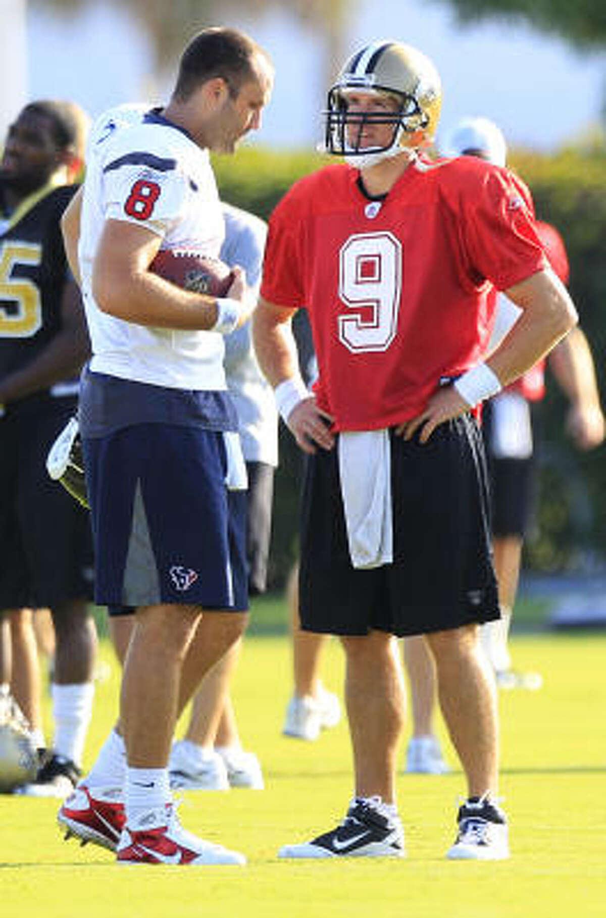 Texans quarterback Matt Schaub (8) and Saints quarterback Drew Brees talk before the start of Thursday's practice.