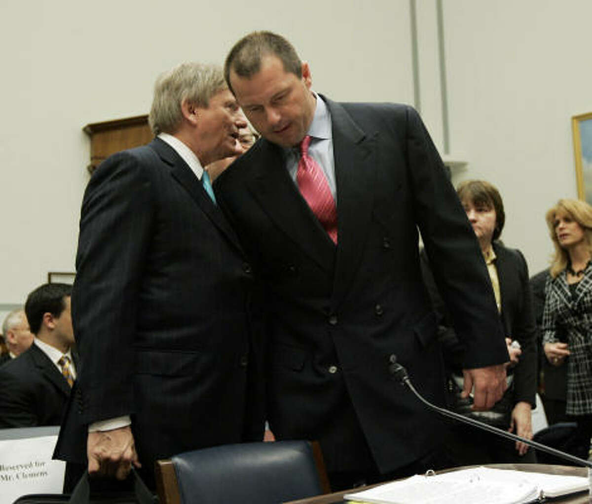 Clemens, right, listens to his attorney Rusty Hardin, left, today on Capitol Hill.