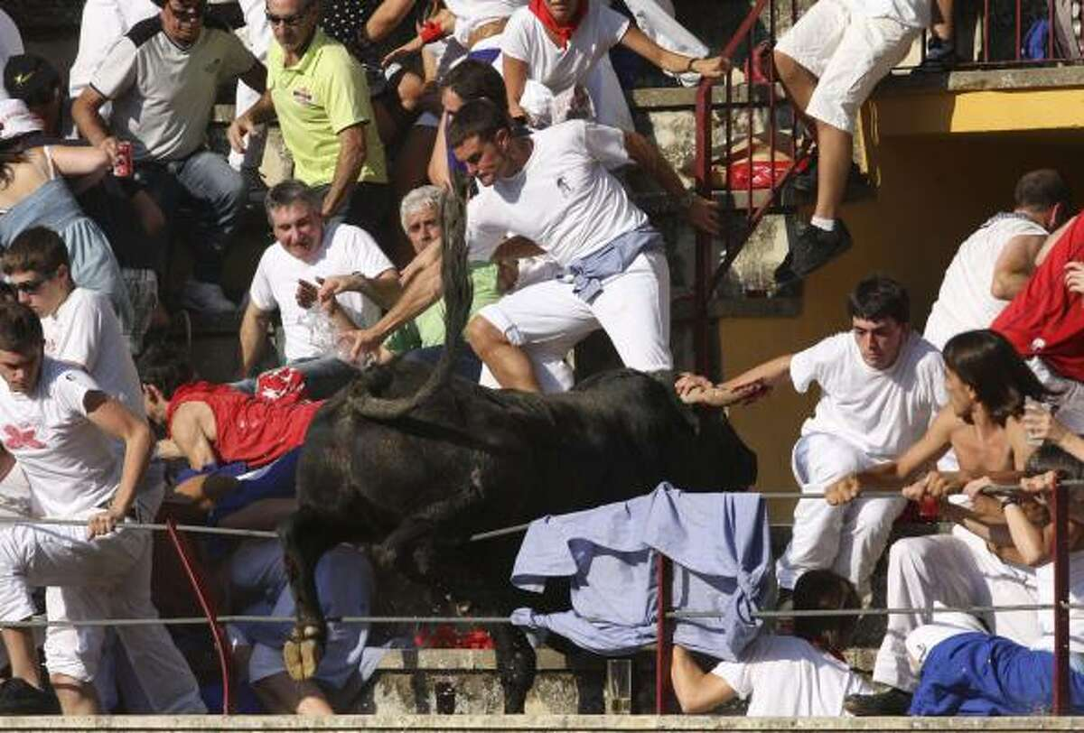 In this Wednesday, Aug. 18, 2010 picture made available Thursday, Aug 19. 2010 a bull leaps into the stands during a bullfight in Tafalla, northern Spain. Up to 40 people were injured when a bull leapt into the packed grandstands of a Spanish bullring and ran amok, charging and trampling on spectators.