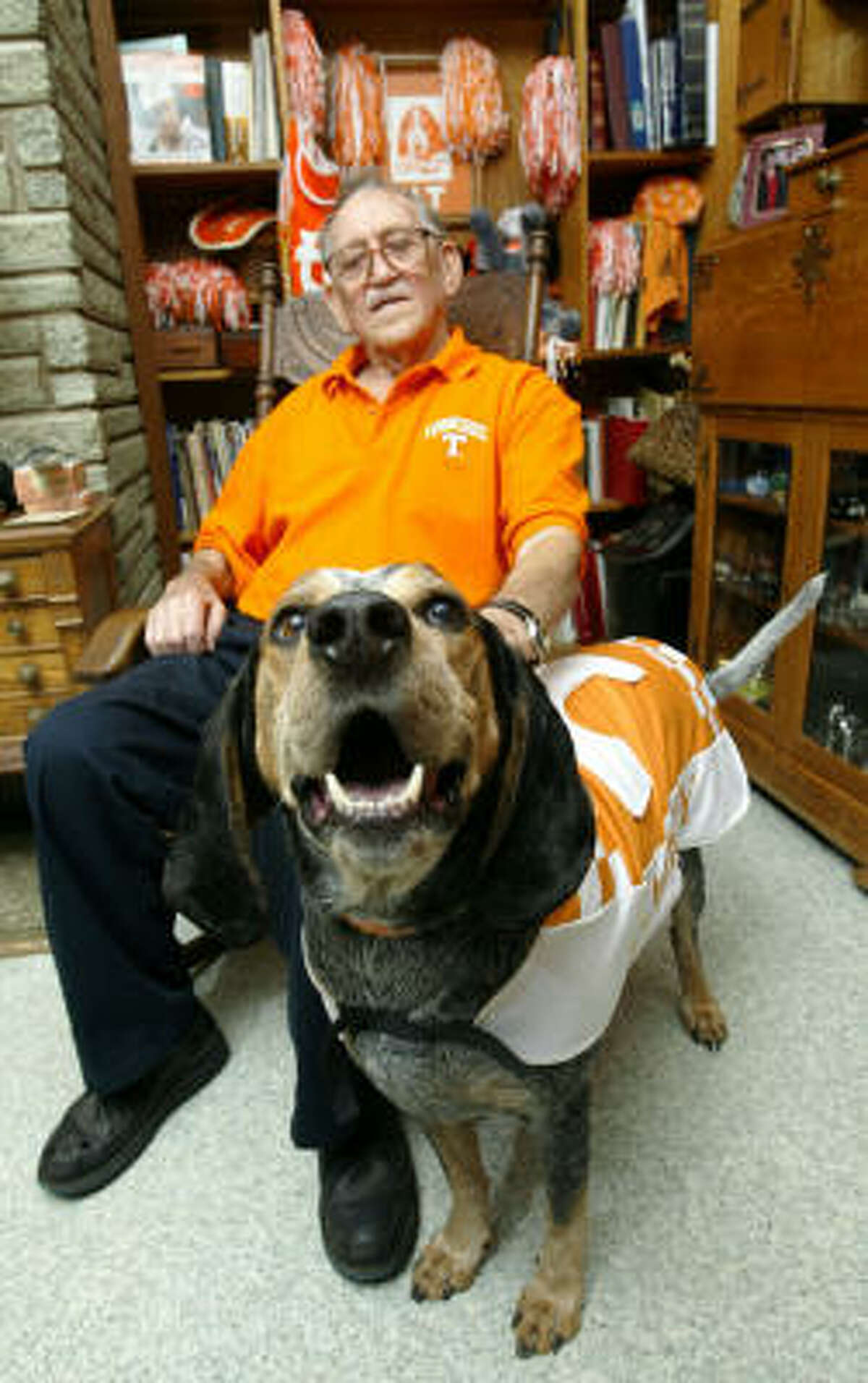 ** FILE ** Earl Hudson, owner of Smokey, the University of Tennessee mascot, poses for a photo at his home Monday, Sept. 22, 2003, in Knoxville, Tenn. Smokey the Eighth will be retired as the University of Tennessee's mascot after the Peach Bowl. Veterinarians at the university say the blue tick coon hound has cancer. The current Smokey has been the team mascot since 1995 and is eighth in a line of Smokies that began in 1953.