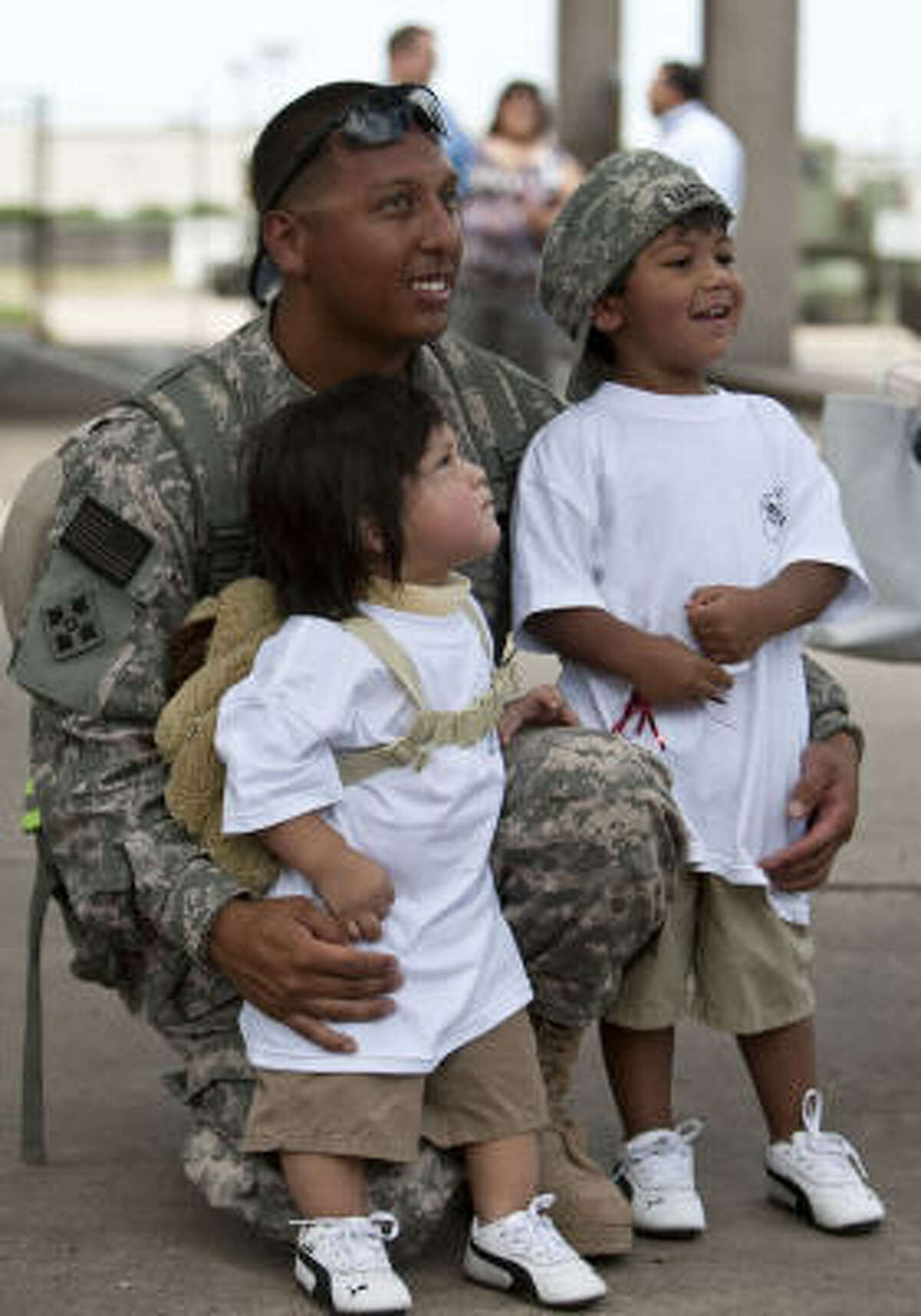 Ssg.Rogelio Martinez poses for a photograph with his son's Armando and Lorenzo Martinez.