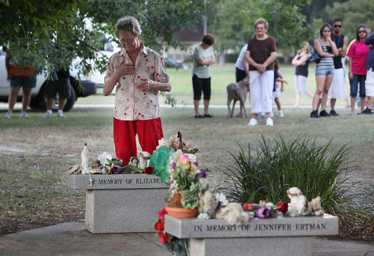 Rose Rogers says a prayer at the memorial for Jennifer Ertman and Elizabeth Pena along T.C. Jester as the community gathers at the same time of Peter Cantu's execution. Peter Anthony Cantu was executed for the brutal murders of Jennifer Ertman, 14, and Elizabeth Pena, 16. Cantu was the ringleader of five gang members who raped and killed the girls at a Houston park - a crime that horrified the city in 1993.