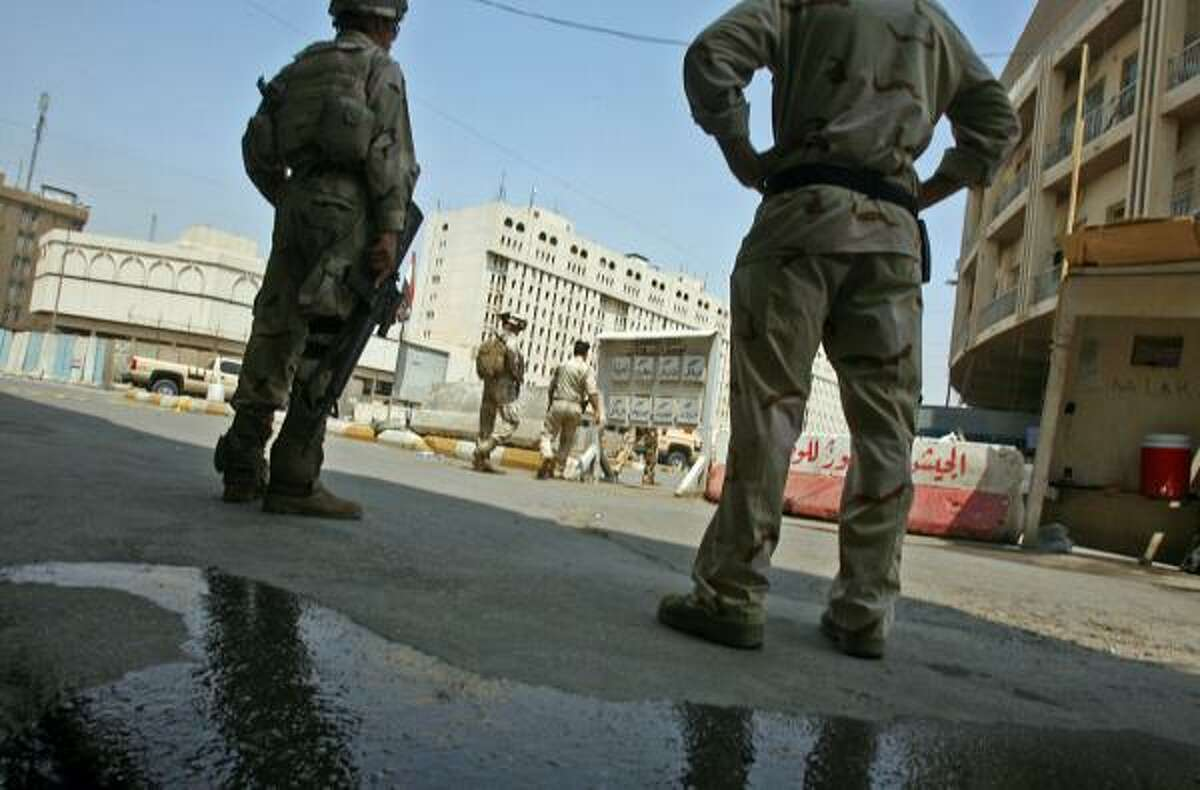 Iraqi soldiers stand guard outside an army recruitment centre in Baghdad on August 17, 2010, following a suicide bombing at the site eaarly in the morning in which more than 40 people were killed, according to the defence ministry.