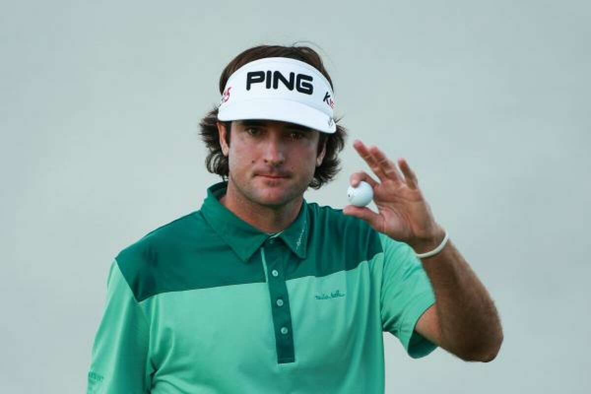Bubba Watson waves to the gallery on the 17th green during the three-hole aggregate playoff. Watson lost the playoff to Martin Kaymer.