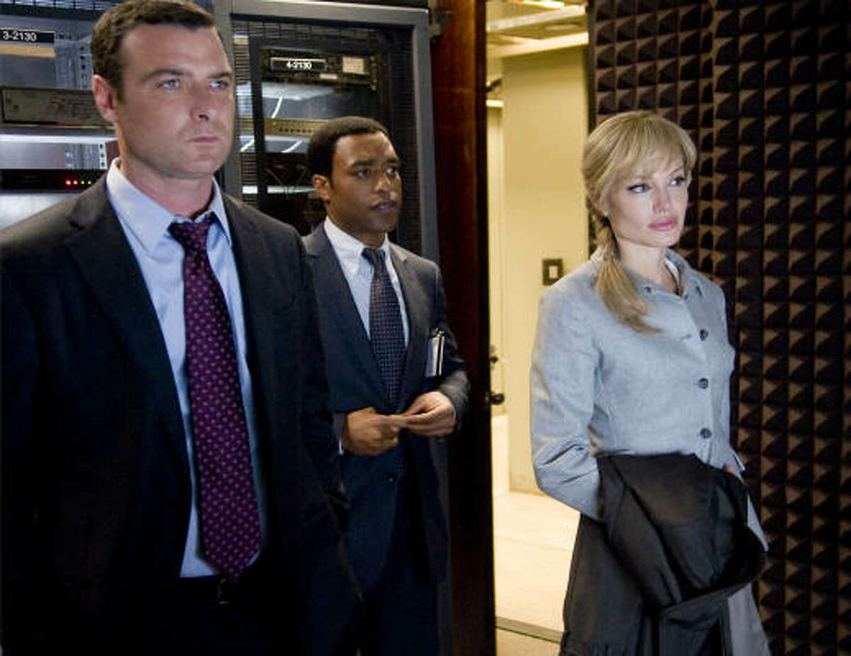 Salt, $6.4 million : Liev Schreiber, left, and Chiwetel Ejiofor have some serious questions to ask Angelina Jolie in the movie about an accused spy.