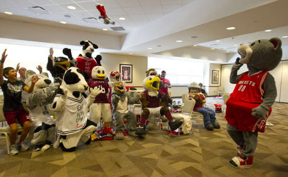 Rockets mascot Clutch tosses a stuffed teddy bear in his likeness into his audience of mascots during Clutch's Fantasy Mascot Camp on Saturday at Toyota Center. Clutch hosted his first fantasy mascot camp, which included personal mascot instruction for performers of all levels, including beginners in high school, collegiate performers, corporate mascots, minor league characters and seasoned professionals. Photo: Karen Warren, Chronicle