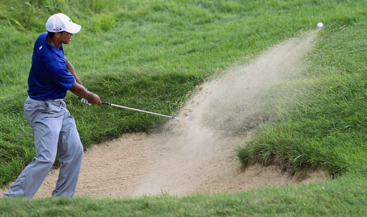 Tiger Woods found almost nothing but trouble early in his third round.