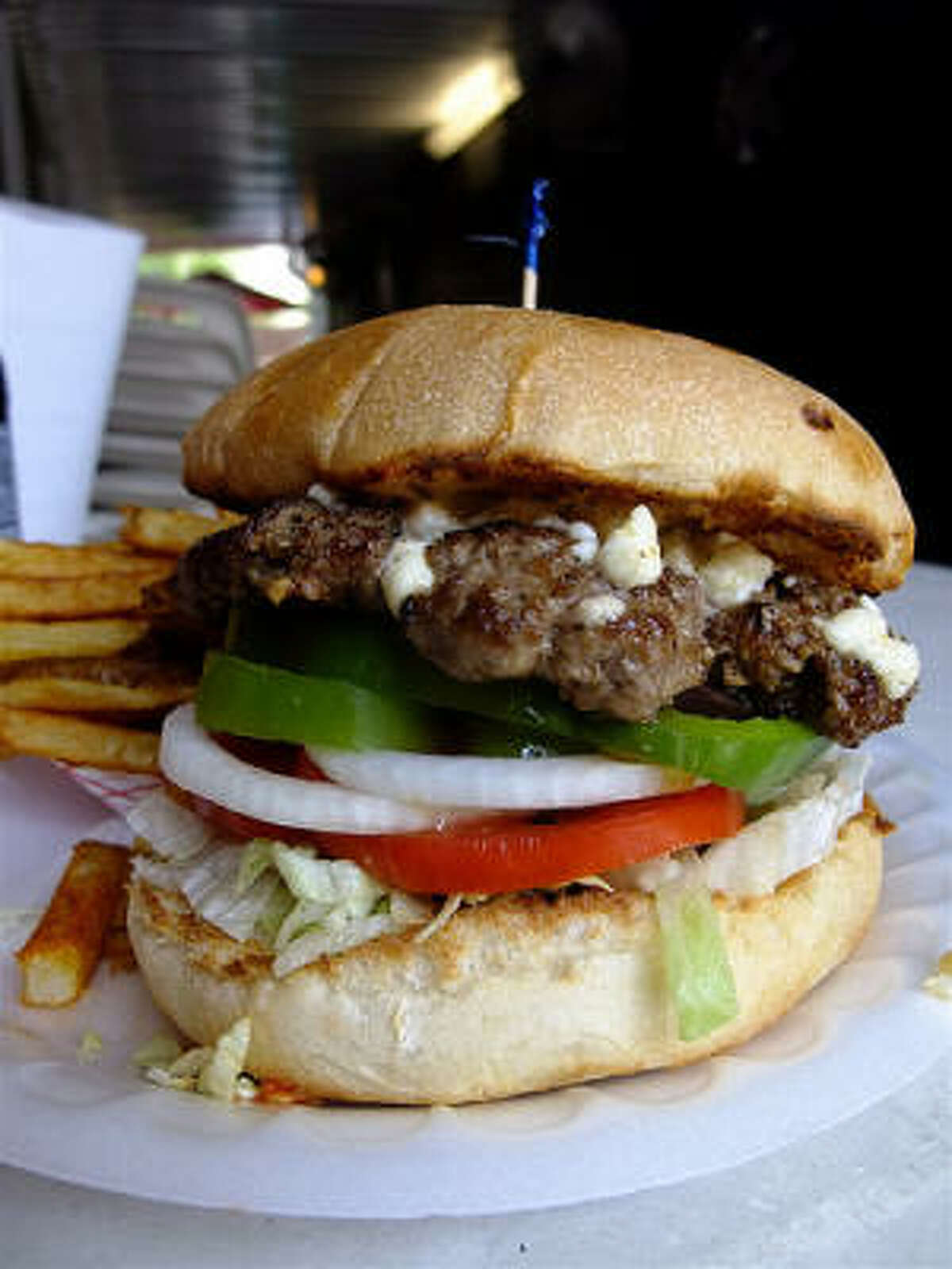 The Greek Burger at Hubcap Grill: with its feta, green pepper, tomato, onion, Kalamata olives & lettuce, it's like eating a Greek salad on a burger. An oregano-laced mayo sauce makes it even better.
