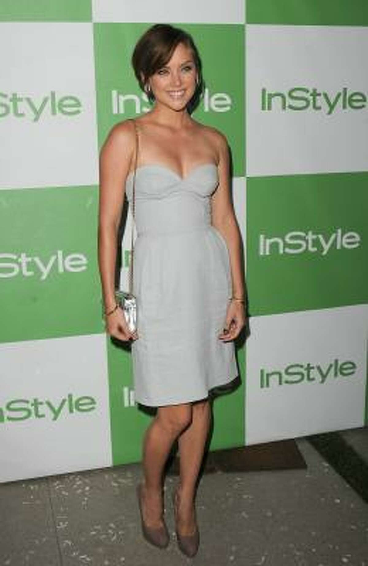 Jessica Stroup The 90210 star certainly knows how to dress for L.A. This summery Stella McCarney dress, with Brian Atwood shoes and Jimmy Choo bag, works perfectly.
