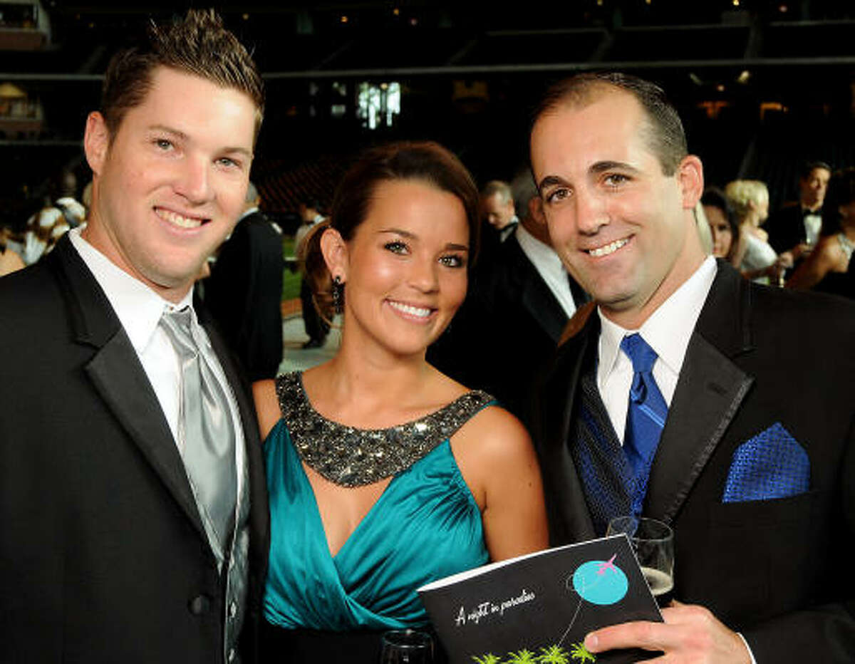 From left: Bud Norris, Aubree Gerardi and Tim Byrdak at the annual Astros Wives Gala at Minute Maid Park.
