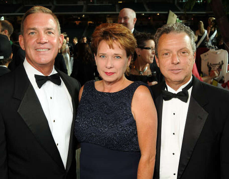 From left: Paul Hill with Liz and Greg Maggio Photo: Dave Rossman, For The Chronicle