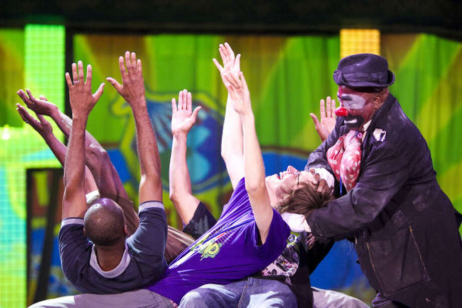 "Onionhead ""The cown from the hood"", top right, helps Logan Rawlings finish a trick during the UniverSoul Circus. UniverSoul Circus Media Coordinator Kyshone Tribble explains UniverSoul is about the soul in your heart, not the color of your skin or your race. Photo: Nick De La Torre, Chronicle"