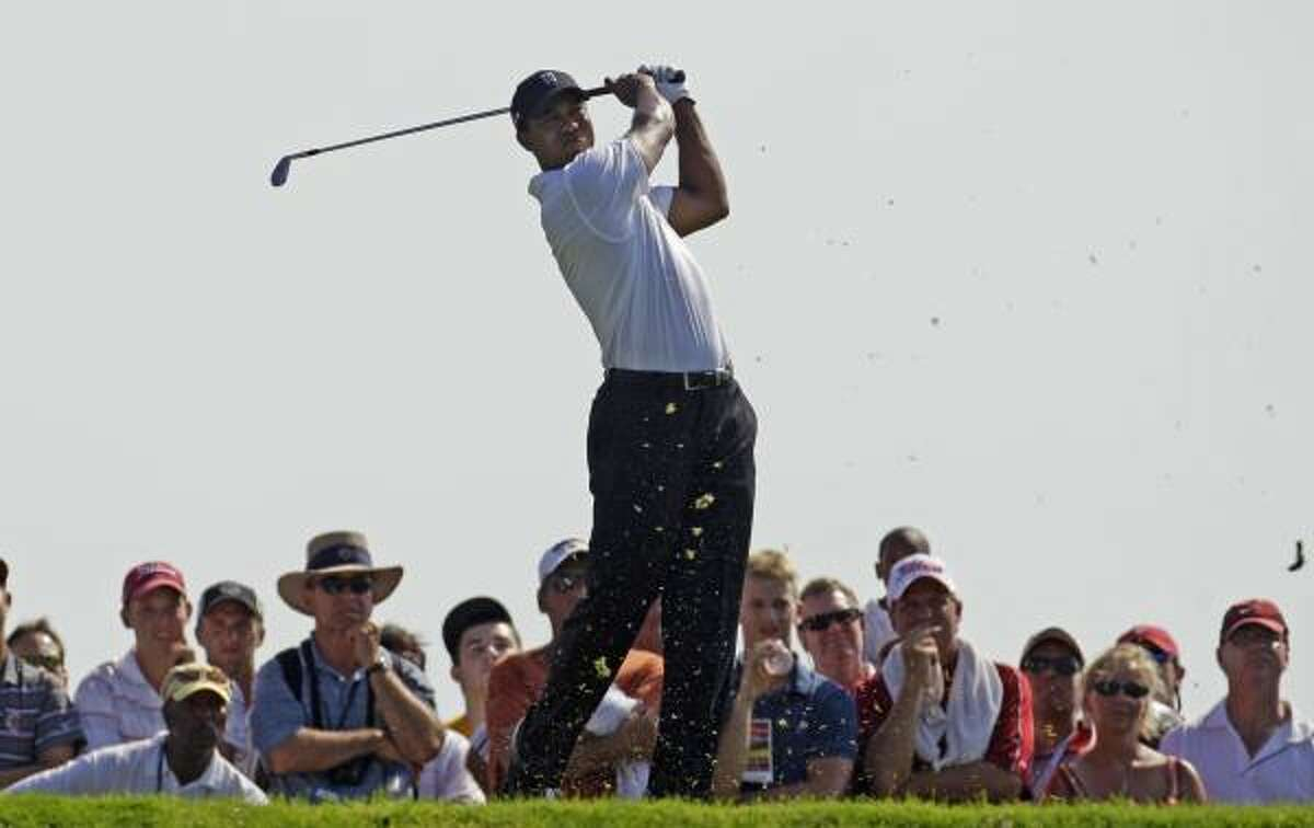 Tiger Woods shot a 1-under-par 71 in the first round of the PGA Championship, finishing three strokes behind leaders Bubba Watson and Francesco Molinari.