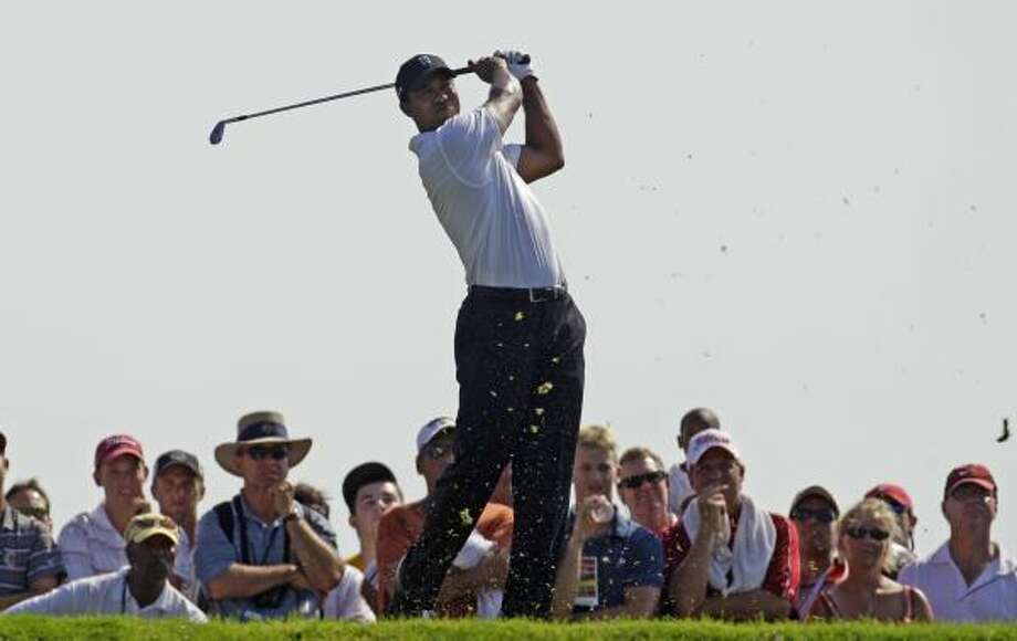Tiger Woods shot a 1-under-par 71 in the first round of the PGA Championship, finishing three strokes behind leaders Bubba Watson and Francesco Molinari. Photo: Eric Gay, AP