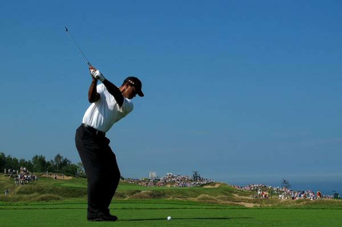 Tiger Woods hits his tee shot on the eighth hole.