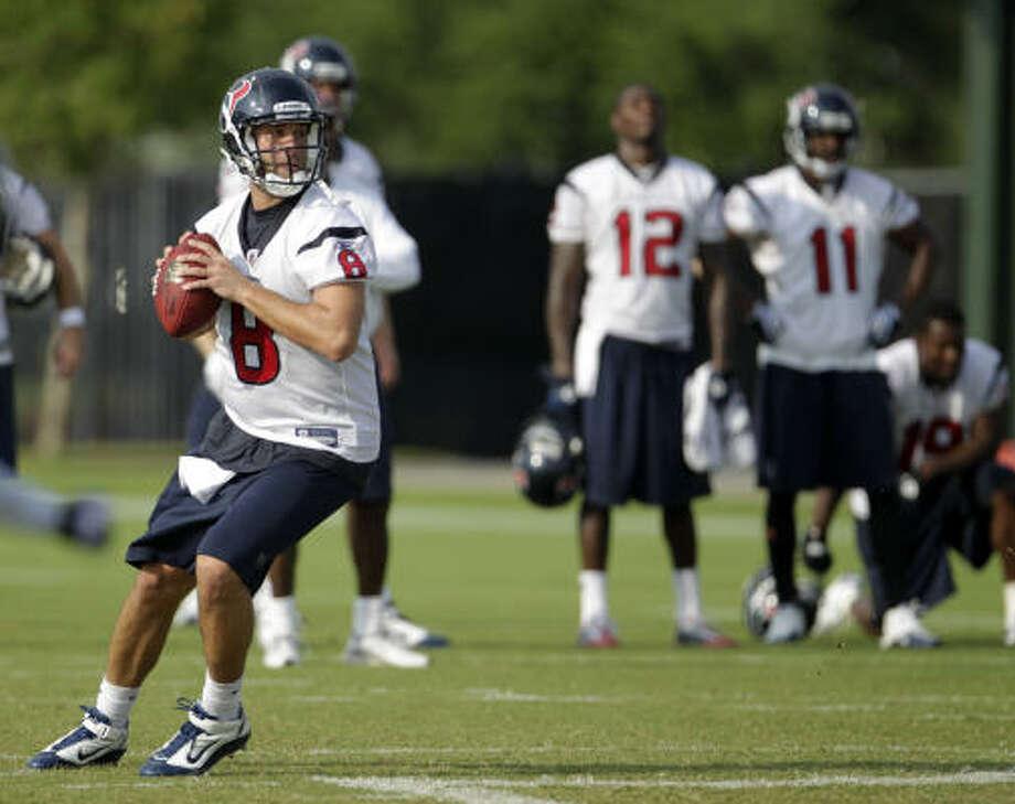 Texans quarterback Matt Schaub drops back to throw the ball at the morning session. Photo: Karen Warren, Chronicle