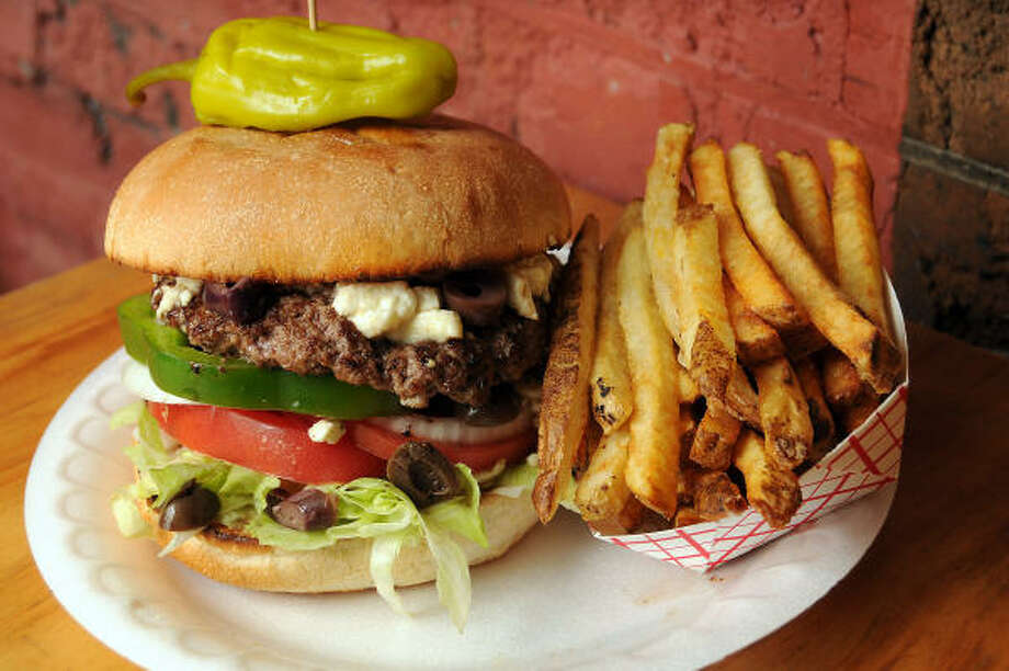 Hubcap GrillRank: 16Cuisine: Burgers/sandwichesEntree price: $-$$Where/Phone: 1111 Prairie, 713-223-5885; 1133 W. 19th, 713-862-0555; 800 Bradford, Kemah, 281-339-7116Website: hubcapgrill.comRead Alison Cook's review of Hubcap Grill Photo: Dave Rossman, For The Chronicle
