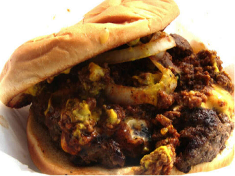 The chili cheeseburger at Sparkle's Burger Spot is the sort of burger extravaganza one inhales with such rapidity it defies both etiquette and common sense. Photo: Alison Cook, Houston Chronicle