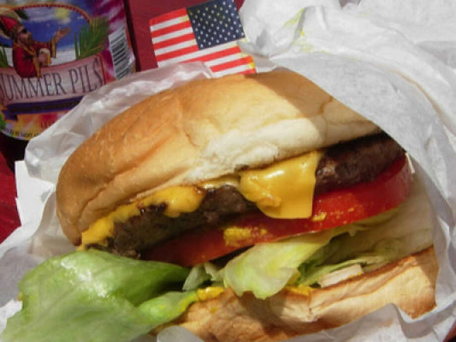 Bubba's Texas Burger Shack's juicy buffalo cheeseburger. It's the whole slidy, sloppy ooze and meaty expansiveness that makes this classically configured burger such a hit. Photo: Alison Cook, Houston Chronicle