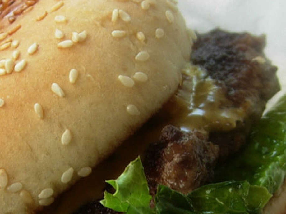 Stanton's City Bites' cheeseburger. Big, in-your-face-beefy and hand-formed, this is a splendid example of the Texas grocery-store hamburger, made fresh on the premises by a painstaking Chinese couple and their small crew. Photo: Alison Cook, Houston Chronicle