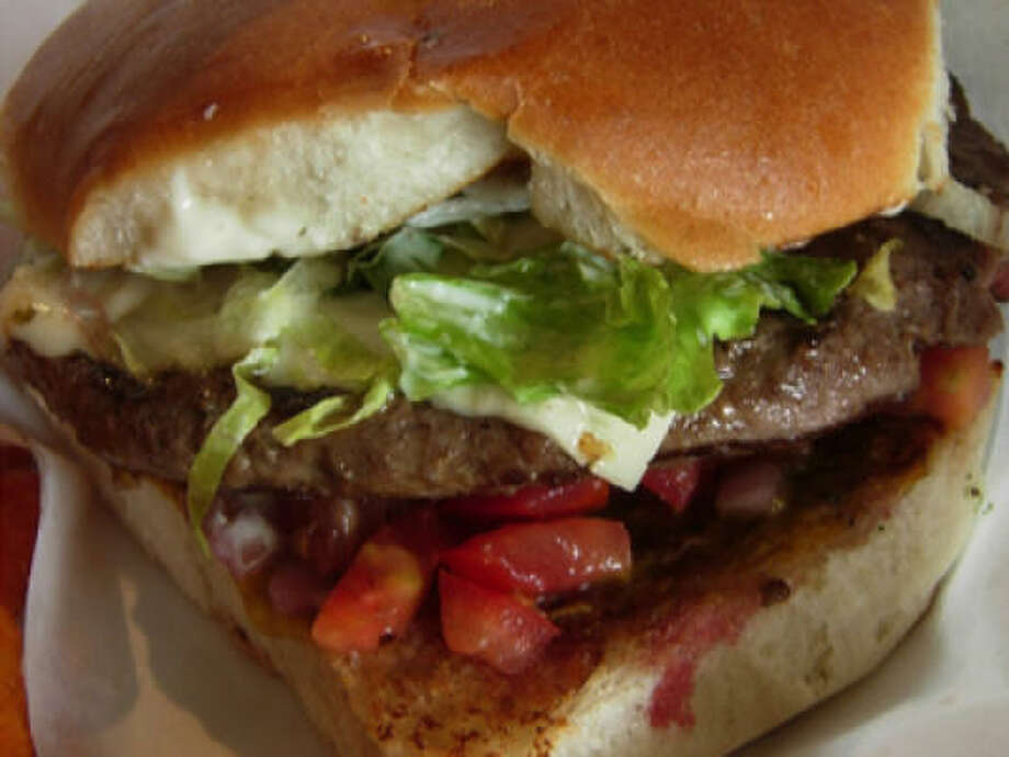 Amazon Grill's cheeseburger, from its silky white cheese to its coarse-crumbed, sweetish bun, adds up to way more than the sum of its parts. Photo: Alison Cook, Houston Chronicle
