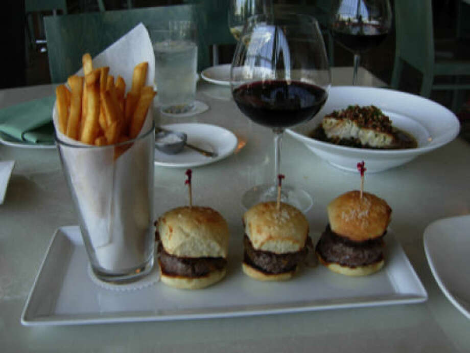 Reef's beef sliders. The integrity of the house-made yeast rolls dusted with sea salt; the excellence of the ground beef; and the luxurious quality of the caramelized onion tangle on top all contribute to an elemental burger experience. Photo: Alison Cook, Houston Chronicle